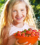Girl with strawberry Royalty Free Stock Image