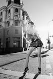 Girl on the street. A girl standing on the street Stock Image