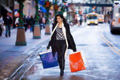 Girl in street with bags Stock Images