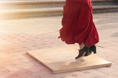 Detail of a flamenco dancer`s feet performing in a street of a Spanish city. Royalty Free Stock Photography