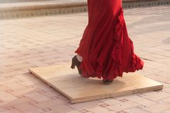 Detail of a flamenco dancer`s feet performing in a street of a Spanish city. Royalty Free Stock Photos