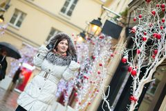 Girl on a street decorated for Christmas Royalty Free Stock Images