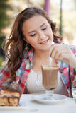 Girl in the street drink a capuccino Stock Image