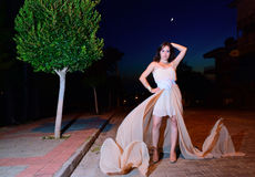 Girl on the street at night in flying dress Royalty Free Stock Photo