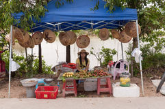 Girl in the street sells fruit Royalty Free Stock Photo