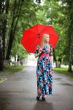 Girl in the street with an umbrella. For a walk on a summer dayr Stock Photos