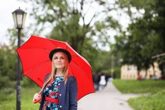 Girl in the street with an umbrella. For a walk on a summer dayr Stock Images
