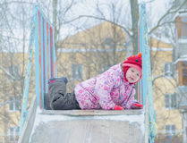 Girl on the street in the winter on icy hill Stock Photo