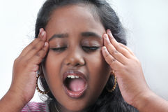 Girl stressed holding head. With open mouth Stock Photos