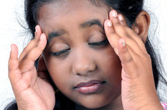 Girl stressed holding head. And closed eyes Royalty Free Stock Image