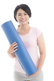 Girl with stretch mat Stock Images