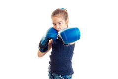 Girl stretched forth her hands in large adult boxing gloves Stock Images