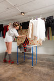 Girl stretches the clothes in the room. Girl housewife stretches clothes in the basement Stock Photos