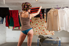 Girl stretches the clothes in the room Stock Photo