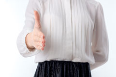 Girl stretches forth his hand to greet close-up Stock Images