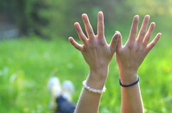 Girl stretches her hands Royalty Free Stock Photo