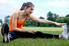 Girl stretching Stock Photography