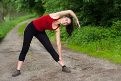 Girl stretching Royalty Free Stock Photo