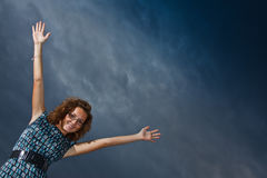 Girl stretching arms into the sky Stock Photo