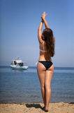 Girl stretching on beach. Thassos island greece, focus is on model Royalty Free Stock Photo