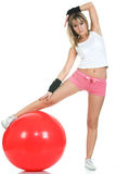 Girl stretching on fit ball Royalty Free Stock Image