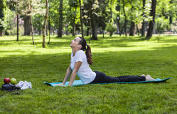 Girl Stretching in a Green Park Stock Photos