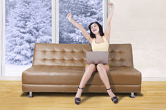 Girl stretching hand in the living room Stock Photos