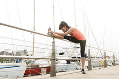 Girl stretching her leg Stock Image