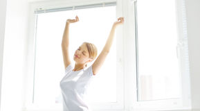 Girl stretching in the morning Royalty Free Stock Photography