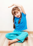 Girl stretching the muscles Stock Image