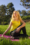 Girl stretching and preparing for yoga Royalty Free Stock Images