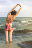Girl stretching at the seaside Royalty Free Stock Image