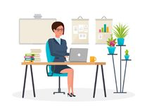 Girl, in strict clothes, working at computer in the office. Stock Images