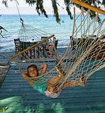 Girl in string hammock royalty free stock images