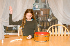 Girl stringing popcorn Stock Image