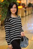 Girl in a striped blouse with a bag Royalty Free Stock Images