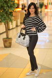 Girl in a striped blouse with a bag Royalty Free Stock Photo
