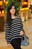 Girl in a striped blouse with a bag Royalty Free Stock Photos