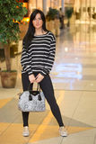 Girl in a striped blouse with a bag. Walks around the store Stock Photography
