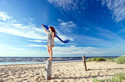 Girl in striped dress on a beach Royalty Free Stock Photography