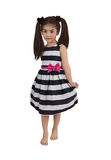 Girl in a striped dress Stock Image