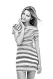 Girl in a striped dress Royalty Free Stock Photos
