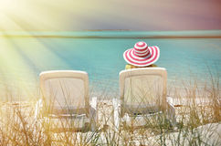 Girl in a striped hat on the beach Royalty Free Stock Image