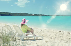 Girl in a striped hat on the beach Royalty Free Stock Images