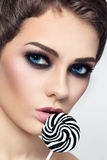 Girl with striped lollipop Stock Photos