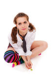 Girl in striped motley knee-length socks Stock Photo