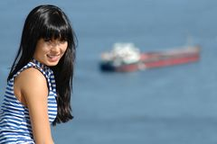 Girl in striped sailor's vest on ship background Stock Photos