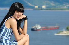 Girl in striped sailor's vest on ship background Stock Photography