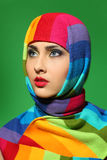 Girl in a striped scarf royalty free stock image