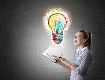Girl in striped shirt with book and lightbulb sketch Royalty Free Stock Photos